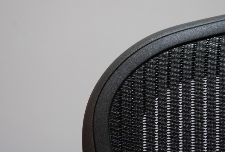office chair dark grey on light grey background_t20_mvbk1r